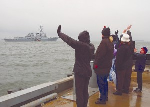 021205-N-4374S-026 Norfolk, Va., (Dec. 5, 2002) -- Friends and families give a farewell to their Sailors and Marines aboard the guided missile destroyer USS Oscar Austin (DDG 79) as she gets underway with the Harry S. Truman Battle Group on a regularly scheduled deployment in support of Operation Enduring Freedom. U.S. Navy Photo by PhotographerÕs Mate 2nd Class Michael Sandberg. (RELEASED)
