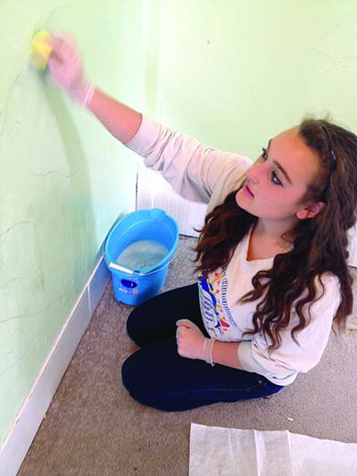 Katie Gigliotti fixing up Louison House.